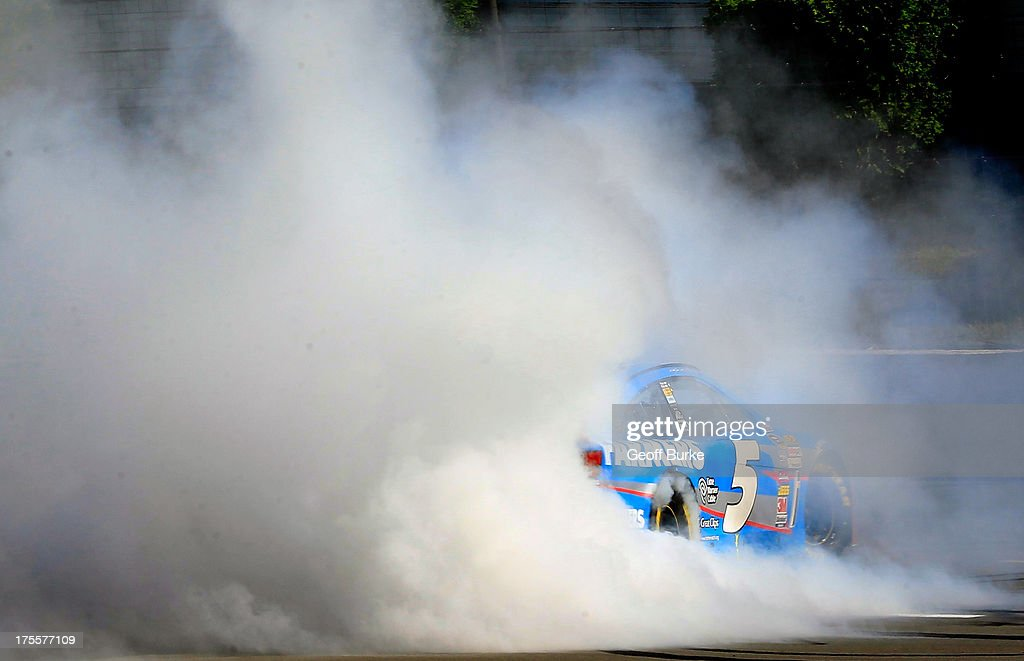 <a gi-track='captionPersonalityLinkClicked' href=/galleries/search?phrase=Kasey+Kahne&family=editorial&specificpeople=183374 ng-click='$event.stopPropagation()'>Kasey Kahne</a>, driver of the #5 Farmers Insurance Chevrolet, celebrates with a burnout after winning the NASCAR Sprint Cup Series GoBowling.com 400 at Pocono Raceway on August 4, 2013 in Long Pond, Pennsylvania.