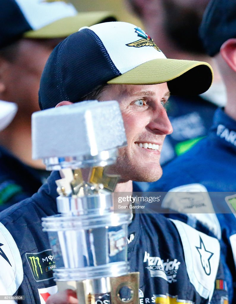 Kasey Kahne, driver of the #5 Farmers Insurance Chevrolet, celebrates with the trophy after winning the Monster Energy NASCAR Cup Series Brickyard 400 at Indianapolis Motorspeedway on July 23, 2017 in Indianapolis, Indiana.