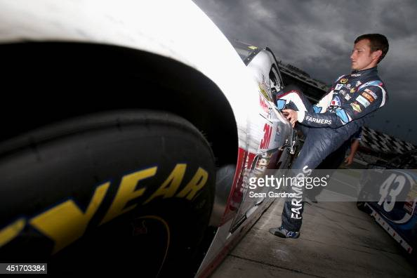 Kasey Kahne driver of the Farmers Insurance Chevrolet climbs into his car during qualifying for the NASCAR Sprint Cup Series Coke Zero 400 at Daytona...