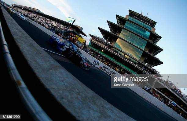 Kasey Kahne driver of the Farmers Insurance Chevrolet crosses the finish line under caution to win the Monster Energy NASCAR Cup Series Brickyard 400...