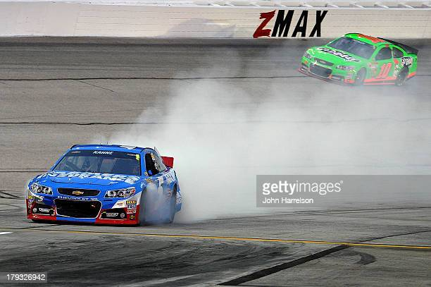 Kasey Kahne driver of the Farmers Insurance Chevrolet drives down pit road after an on track incident during the NASCAR Sprint Cup Series AdvoCare...