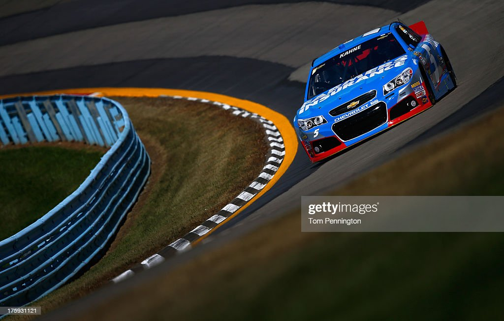 <a gi-track='captionPersonalityLinkClicked' href=/galleries/search?phrase=Kasey+Kahne&family=editorial&specificpeople=183374 ng-click='$event.stopPropagation()'>Kasey Kahne</a>, driver of the #5 Farmers Insurance Chevrolet, drives during qualifying for the NASCAR Sprint Cup Series Cheez-It 355 at The Glen at Watkins Glen International on August 10, 2013 in Watkins Glen, New York.