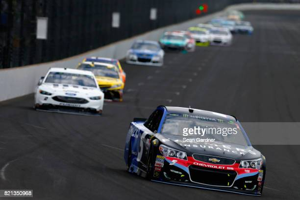 Kasey Kahne driver of the Farmers Insurance Chevrolet leads a pack of cars during the Monster Energy NASCAR Cup Series Brickyard 400 at Indianapolis...
