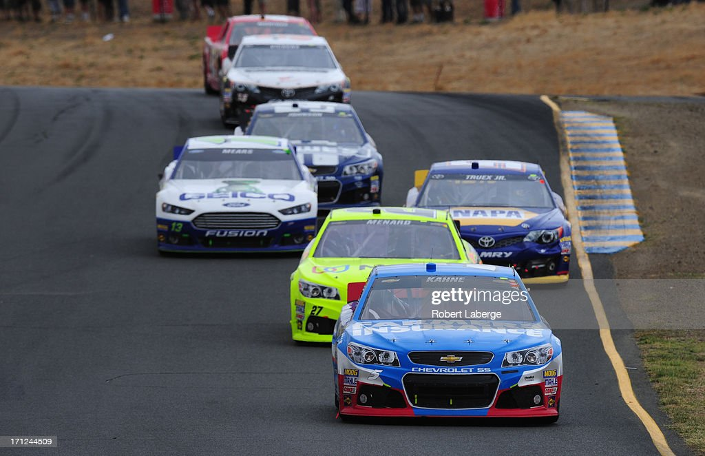 Kasey Kahne, driver of the #5 Farmers Insurance Chevrolet, leads Paul Menard, driver of the #27 Menard's / Moen Chevrolet, uring the NASCAR Sprint Cup Series Toyota/Save Mart 350 at Sonoma Raceway on June 23, 2013 in Sonoma, California.