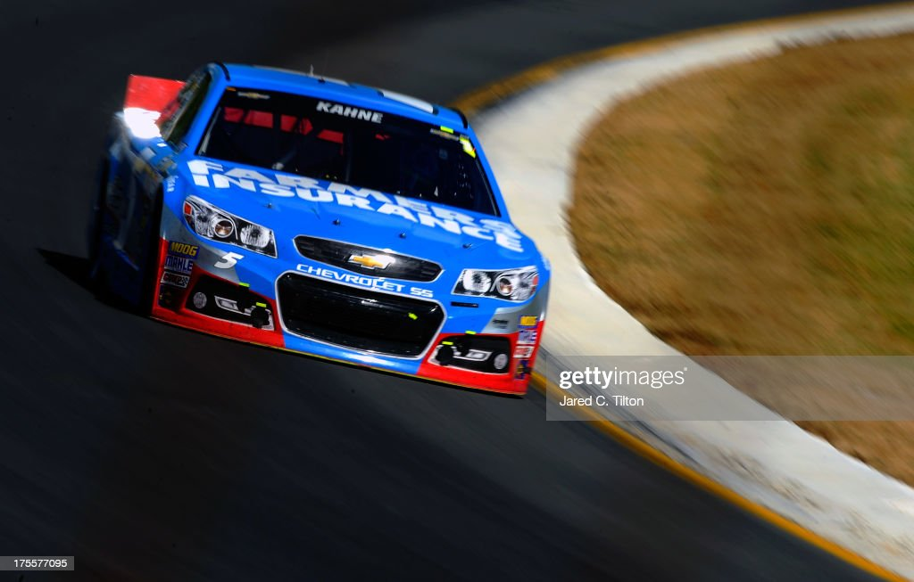 <a gi-track='captionPersonalityLinkClicked' href=/galleries/search?phrase=Kasey+Kahne&family=editorial&specificpeople=183374 ng-click='$event.stopPropagation()'>Kasey Kahne</a>, driver of the #5 Farmers Insurance Chevrolet, leads the field during the NASCAR Sprint Cup Series GoBowling.com 400 at Pocono Raceway on August 4, 2013 in Long Pond, Pennsylvania.