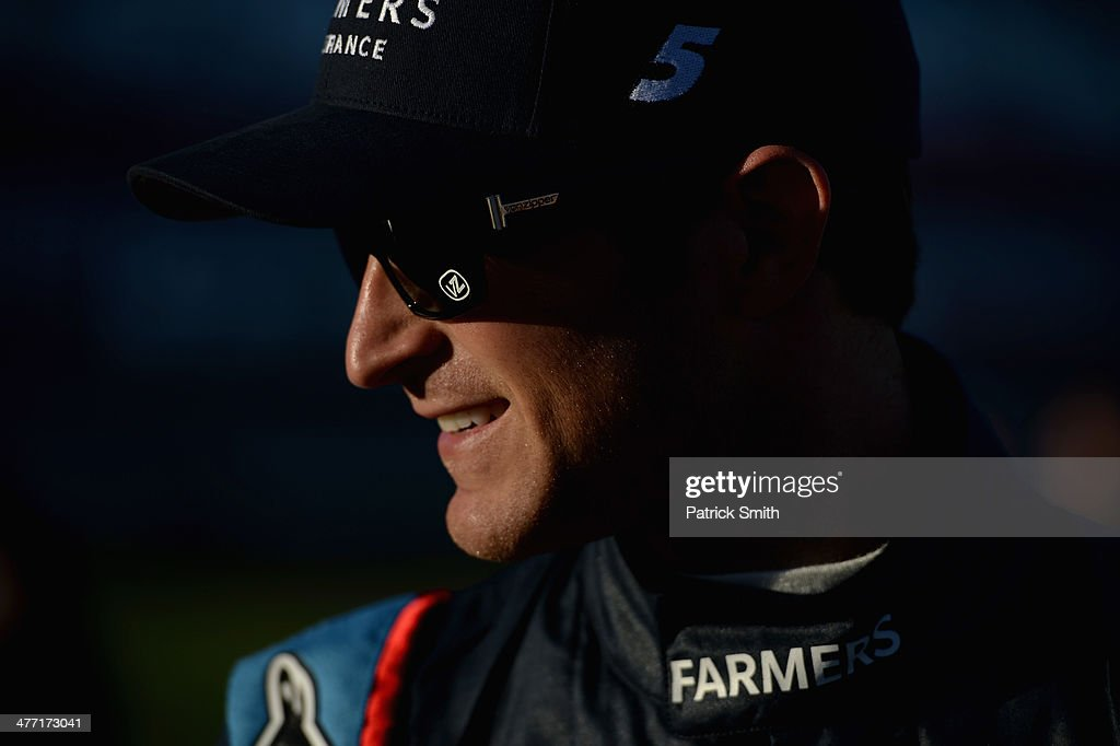 <a gi-track='captionPersonalityLinkClicked' href=/galleries/search?phrase=Kasey+Kahne&family=editorial&specificpeople=183374 ng-click='$event.stopPropagation()'>Kasey Kahne</a>, driver of the #5 Farmers Insurance Chevrolet, looks on during qualifying for the NASCAR Sprint Cup Series Kobalt 400 at Las Vegas Motor Speedway on March 7, 2014 in Las Vegas, Nevada.