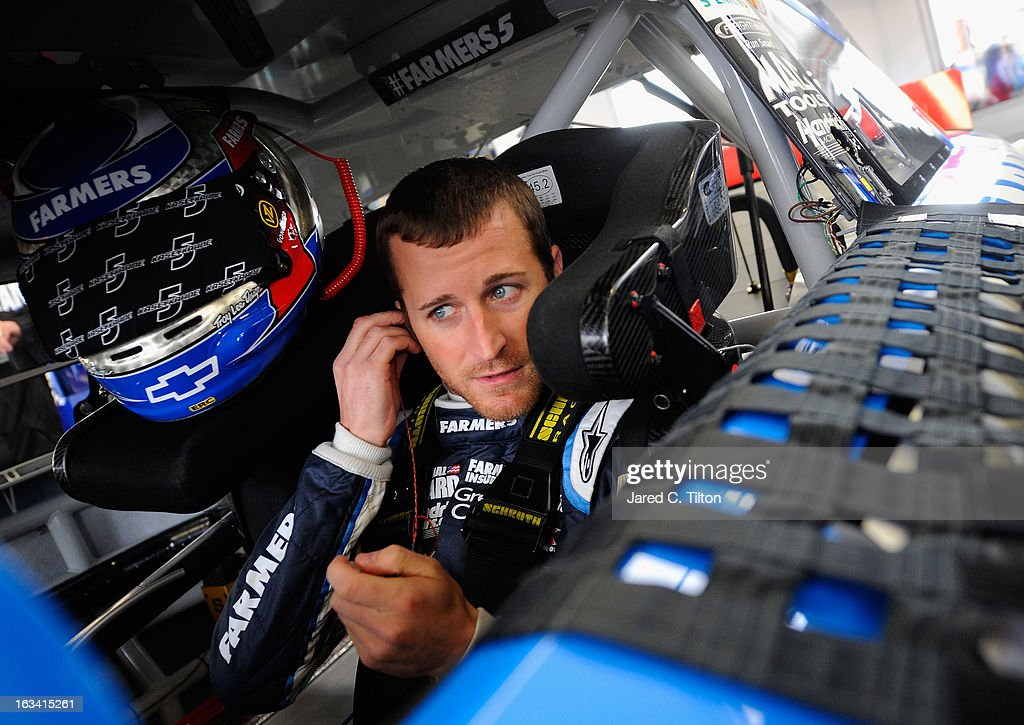 Kasey Kahne, driver of the #5 Farmers Insurance Chevrolet, sits in his car in the garage area during practice for the NASCAR Sprint Cup Series Kobalt Tools 400 at Las Vegas Motor Speedway on March 9, 2013 in Las Vegas, Nevada.