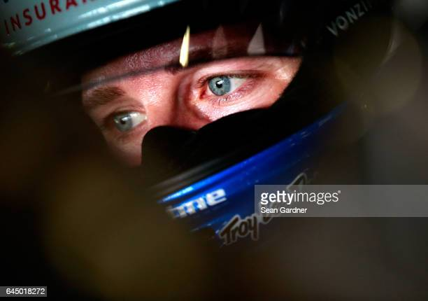 Kasey Kahne driver of the Farmers Insurance Chevrolet sits in his car during practice for the 59th Annual DAYTONA 500 at Daytona International...