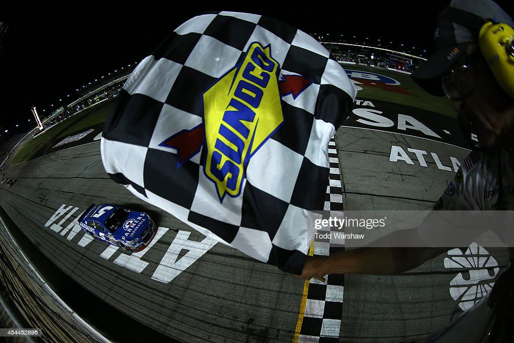 Kasey Kahne driver of the Farmers Insurance Chevrolet takes the checkered flag to win the NASCAR Sprint Cup Series OralB USA 500 at Atlanta Motor...