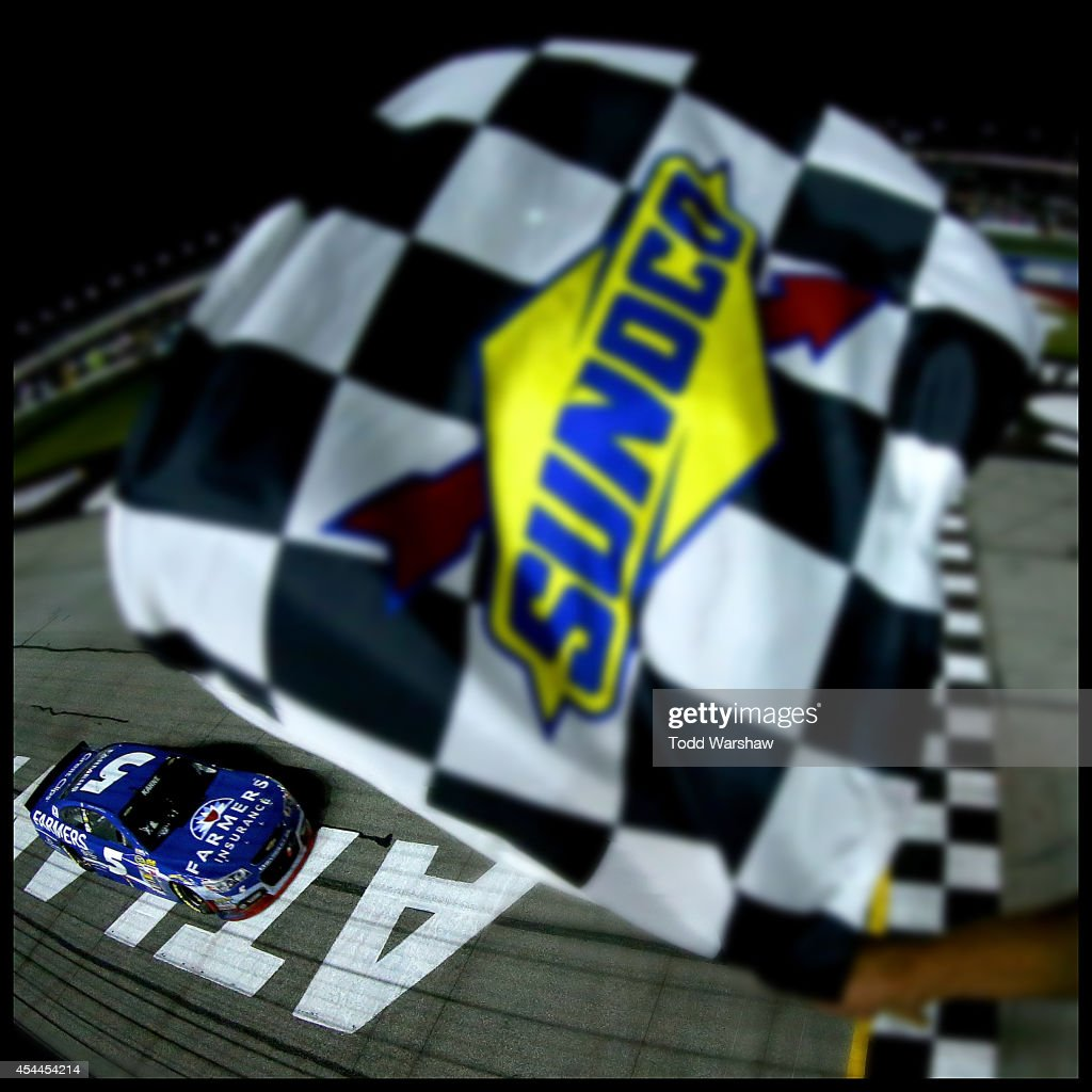 <a gi-track='captionPersonalityLinkClicked' href=/galleries/search?phrase=Kasey+Kahne&family=editorial&specificpeople=183374 ng-click='$event.stopPropagation()'>Kasey Kahne</a>, driver of the #5 Farmers Insurance Chevrolet, takes the checkered flag to win the NASCAR Sprint Cup Series Oral-B USA 500 at Atlanta Motor Speedway on August 31, 2014 in Hampton, Georgia.