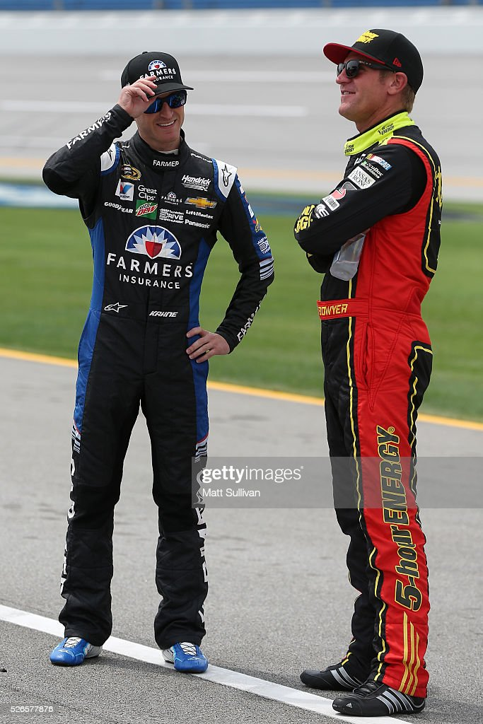 Kasey Kahne, driver of the #5 Farmers Insurance Chevrolet, talks to Clint Bowyer, driver of the #15 AccuDoc Solutions Chevrolet, on the grid during qualifying for the NASCAR Sprint Cup Series GEICO 500 at Talladega Superspeedway on April 30, 2016 in Talladega, Alabama.