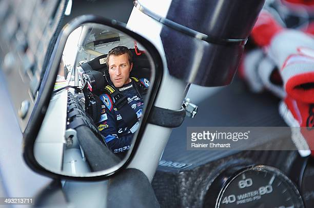 Kasey Kahne driver of the FarmersInsurance/Thankamillionteacherscom Chevrolet sits in his car during qualifying for the NASCAR Sprint Cup Series...