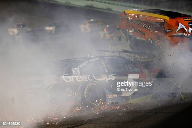 Kasey Kahne driver of the Great Clips Chevrolet and Carl Edwards driver of the ARRIS Toyota are involved in an ontrack incident during the NASCAR...