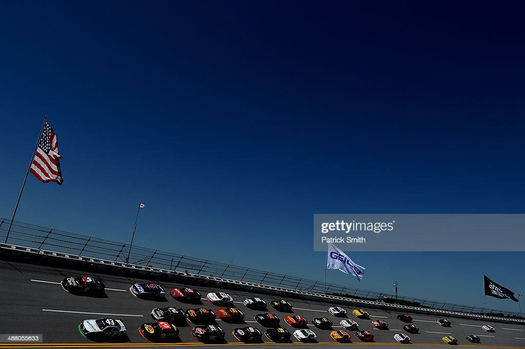 Kasey Kahne, driver of the #5 Great Clips Chevrolet, and Dakoda Armstrong, driver of the #43 WinField Ford, lead the field during the NASCAR Nationwide Series Aaron's 312 at Talladega Superspeedway on May 3, 2014 in Talladega, Alabama.