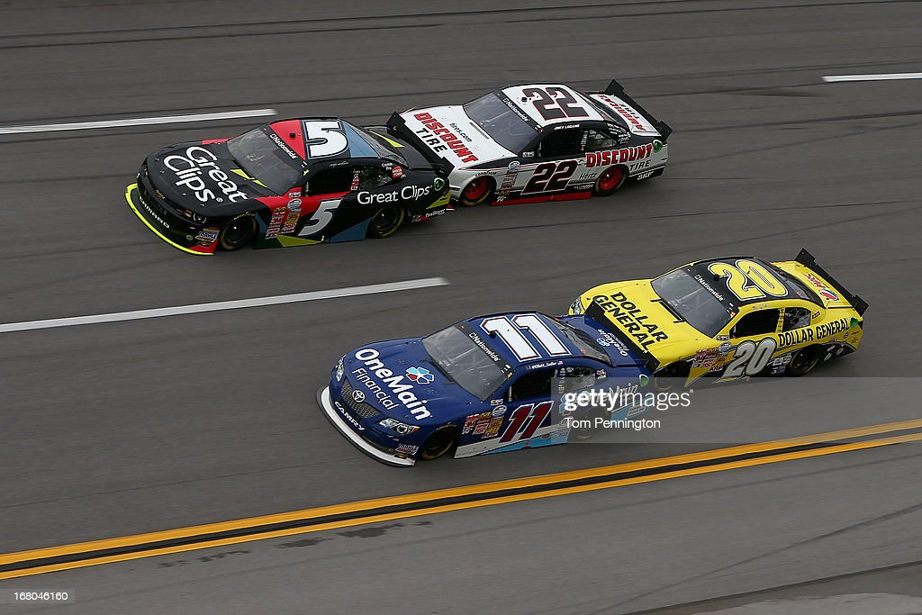 Kasey Kahne, driver of the #5 Great Clips Chevrolet and Joey Logano, driver of the #22 Discount Tire Ford, draft as they race side by each against Elliott Sadler, driver of the #11 OneMain Financial Toyota and Brian Vickers, driver of the #20 Dollar General Toyota, during the NASCAR Nationwide Series Aaron's 312 at Talladega Superspeedway on May 4, 2013 in Talladega, Alabama.