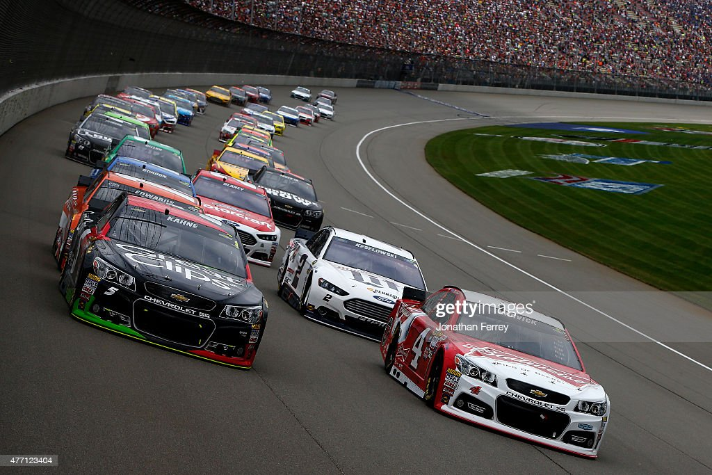 Kasey Kahne driver of the Great Clips Chevrolet and Kevin Harvick driver of the Budweiser/Jimmy John's Chevrolet lead the field to start the NASCAR...