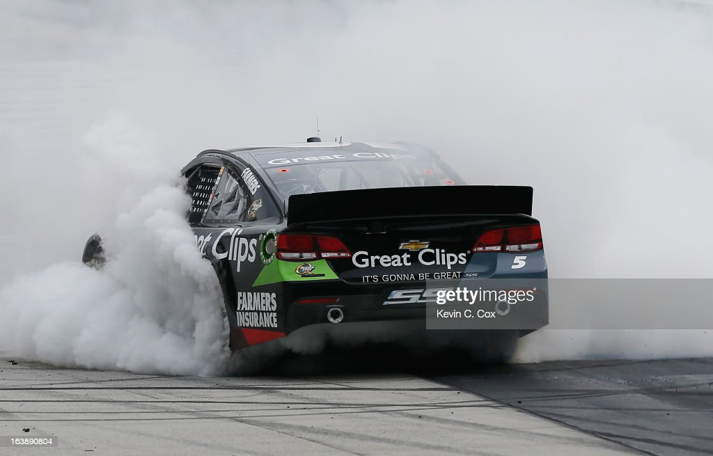 <a gi-track='captionPersonalityLinkClicked' href=/galleries/search?phrase=Kasey+Kahne&family=editorial&specificpeople=183374 ng-click='$event.stopPropagation()'>Kasey Kahne</a>, driver of the #5 Great Clips Chevrolet, celebrates with a burnout after winning the NASCAR Sprint Cup Series Food City 500 at Bristol Motor Speedway on March 17, 2013 in Bristol, Tennessee.