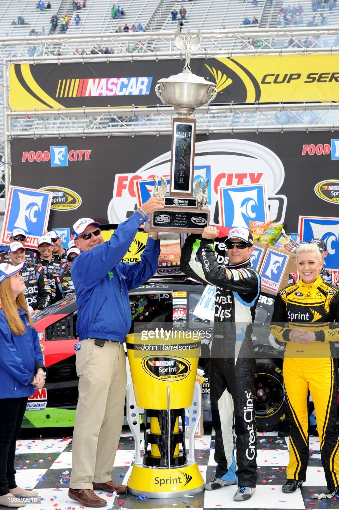 Kasey Kahne, driver of the #5 Great Clips Chevrolet, celebrates with the trophy in Victory Lane after winning the NASCAR Sprint Cup Series Food City 500 at Bristol Motor Speedway on March 17, 2013 in Bristol, Tennessee.