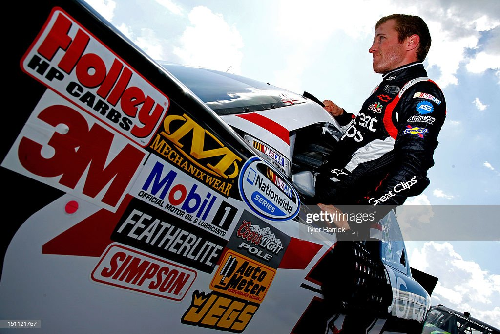 <a gi-track='captionPersonalityLinkClicked' href=/galleries/search?phrase=Kasey+Kahne&family=editorial&specificpeople=183374 ng-click='$event.stopPropagation()'>Kasey Kahne</a>, driver of the #38 Great Clips Chevrolet, climbs out of his car during qualifying for the NASCAR Nationwide Series NRA American Warrior 300 at Atlanta Motor Speedway on September 1, 2012 in Hampton, Georgia.