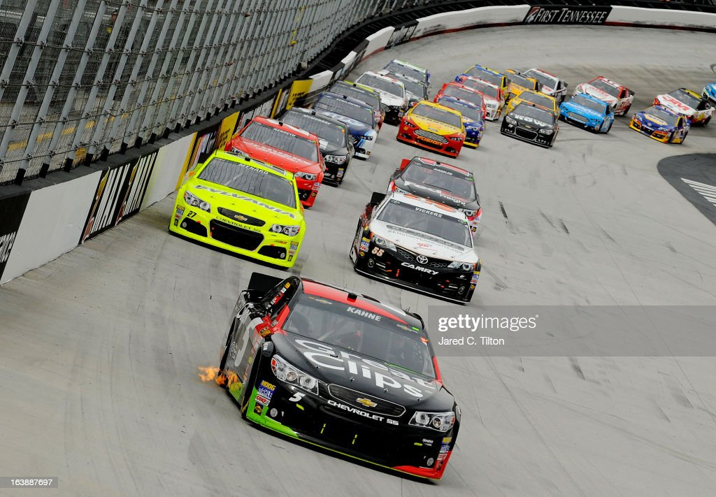 Kasey Kahne, driver of the #5 Great Clips Chevrolet, leads a group of cars during the NASCAR Sprint Cup Series Food City 500 at Bristol Motor Speedway on March 17, 2013 in Bristol, Tennessee.