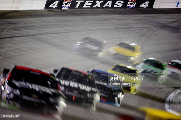 Kasey Kahne driver of the Great Clips Chevrolet leads a pack of cars during the NASCAR Sprint Cup Series Duck Commander 500 at Texas Motor Speedway...