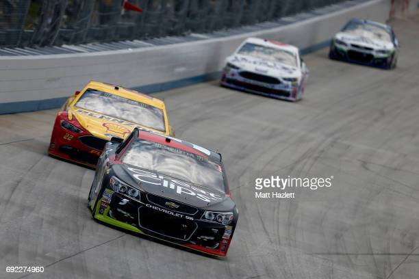 Kasey Kahne driver of the Great Clips Chevrolet leads a pack of cars during the Monster Energy NASCAR Cup Series AAA 400 Drive for Autism at Dover...