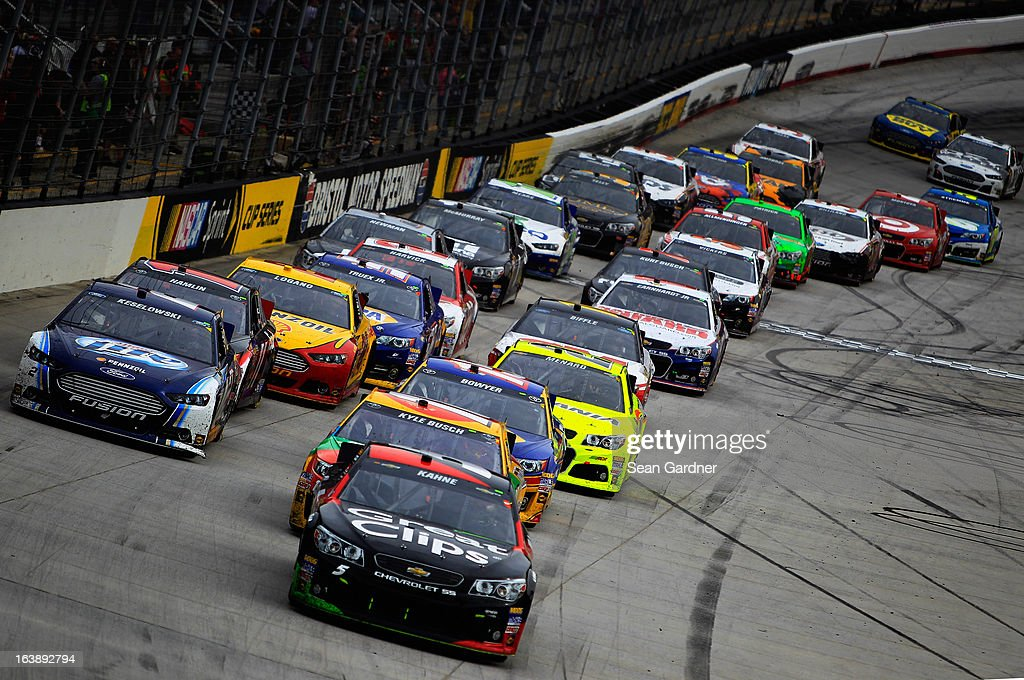 Kasey Kahne, driver of the #5 Great Clips Chevrolet, leads the field on a restart during the NASCAR Sprint Cup Series Food City 500 at Bristol Motor Speedway on March 17, 2013 in Bristol, Tennessee.