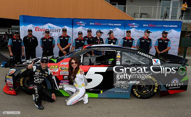Kasey Kahne driver of the Great Clips Chevrolet poses with Miss Coors Light Amanda Mertz after winning the pole during qualifying for the NASCAR...