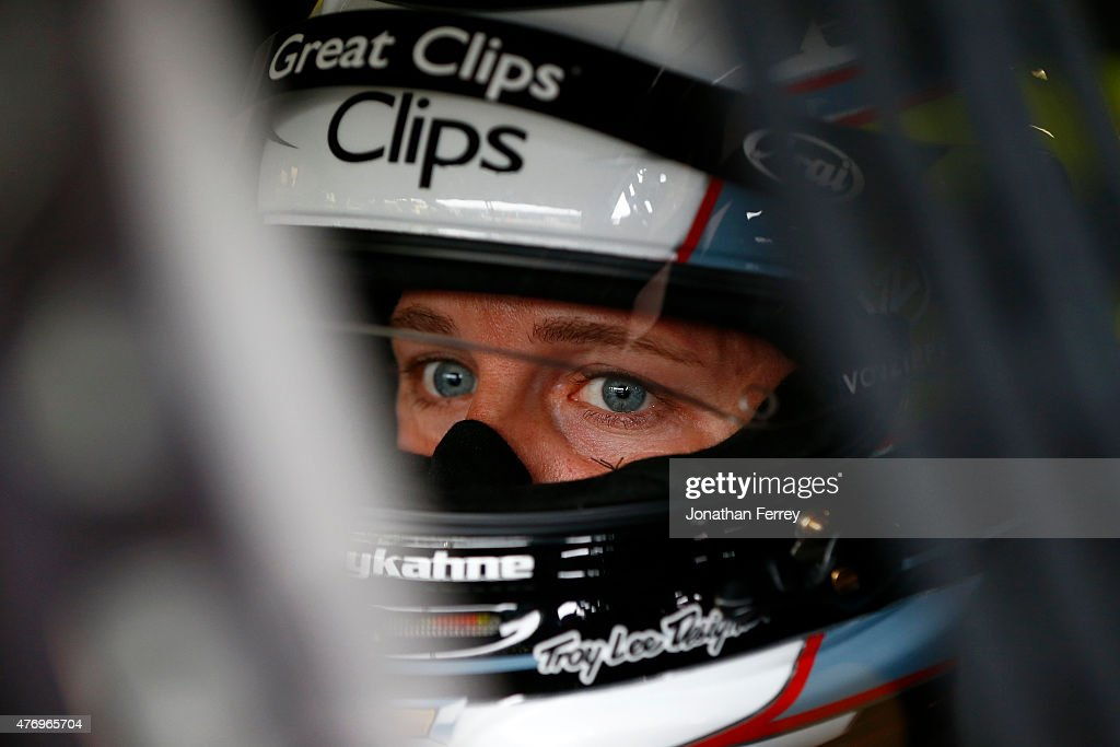 Kasey Kahne driver of the Great Clips Chevrolet sits in his car during practice for the NASCAR Sprint Cup Series Quicken Loans 400 at Michigan...