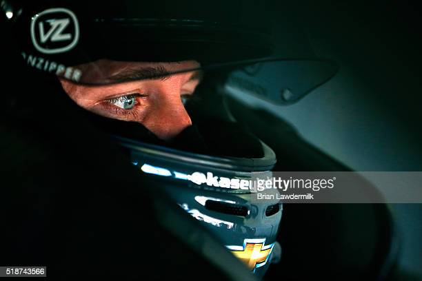 Kasey Kahne driver of the Great Clips Chevrolet sits in his car during practice for the NASCAR Sprint Cup Series STP 500 at Martinsville Speedway on...