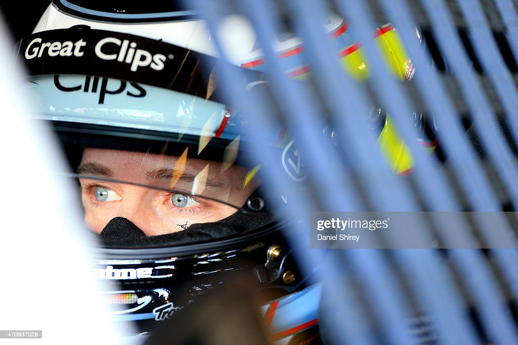 Kasey Kahne driver of the Great Clips Chevrolet sits in his car in the garage during practice for the NASCAR Sprint Cup Series Toyota Owners 400 at...
