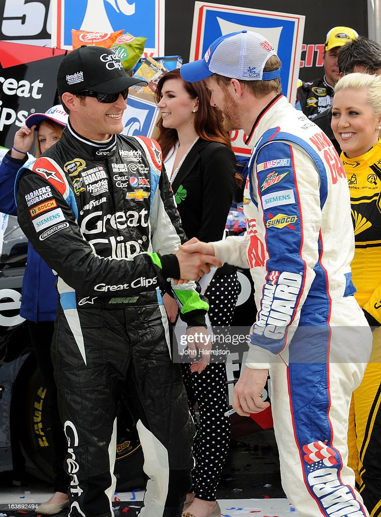 Kasey Kahne, driver of the #5 Great Clips Chevrolet, speaks with Dale Earnhardt Jr., driver of the #88 National Guard Chevrolet, in victory lane after winning the NASCAR Sprint Cup Series Food City 500 at Bristol Motor Speedway on March 17, 2013 in Bristol, Tennessee.