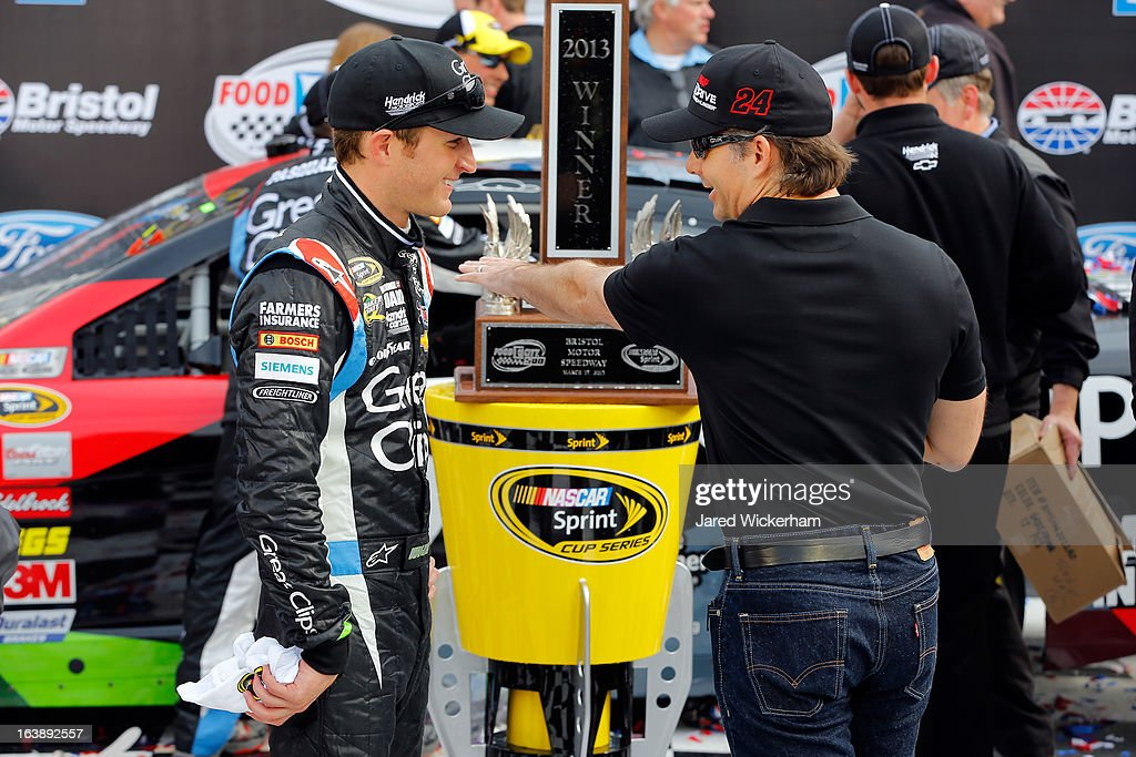 Kasey Kahne, driver of the #5 Great Clips Chevrolet, speaks with Jeff Gordon, driver of the #24 Drive To End Hunger Chevrolet, in Victory Lane after winning the NASCAR Sprint Cup Series Food City 500 at Bristol Motor Speedway on March 17, 2013 in Bristol, Tennessee.
