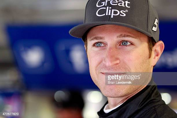 Kasey Kahne driver of the Great Clips Chevrolet stands in the garage during practice for the NASCAR Sprint Cup Series SpongeBob SquarePants 400 at...