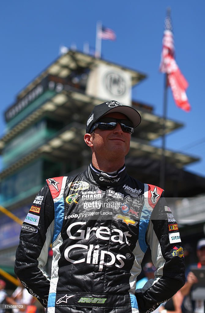 <a gi-track='captionPersonalityLinkClicked' href=/galleries/search?phrase=Kasey+Kahne&family=editorial&specificpeople=183374 ng-click='$event.stopPropagation()'>Kasey Kahne</a>, driver of the #5 Great Clips Chevrolet, stands on the grid during qualifying for the NASCAR Sprint Cup Series Samuel Deeds 400 At The Brickyard at Indianapolis Motor Speedway on July 27, 2013 in Indianapolis, Indiana.