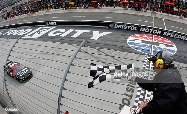 Kasey Kahne driver of the Great Clips Chevrolet takes the checkered flag to win the NASCAR Sprint Cup Food City 500 at Bristol Motor Speedway on...