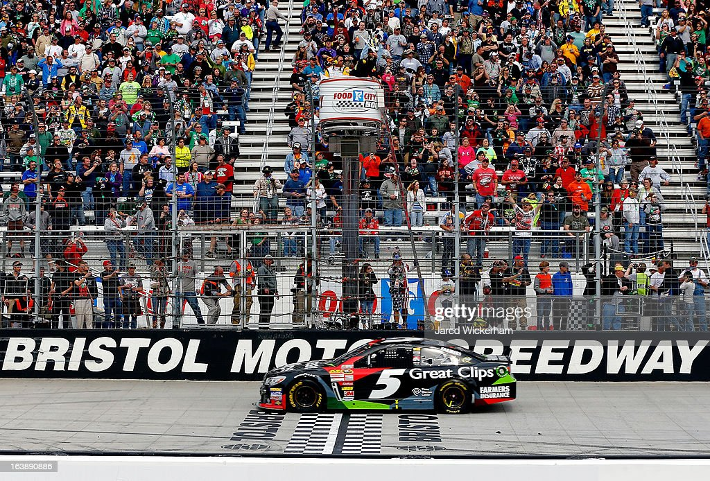 Kasey Kahne, driver of the #5 Great Clips Chevrolet, takes the checkered flag to win the NASCAR Sprint Cup Food City 500 at Bristol Motor Speedway on March 17, 2013 in Bristol, Tennessee.