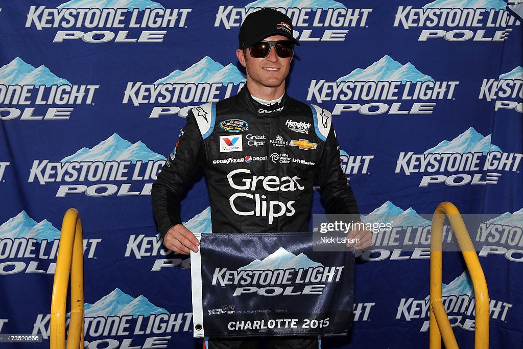 Kasey Kahne driver of the Haas Automation Chevrolet poses after qualifying for the pole position for the NASCAR Camping World Truck Series North...