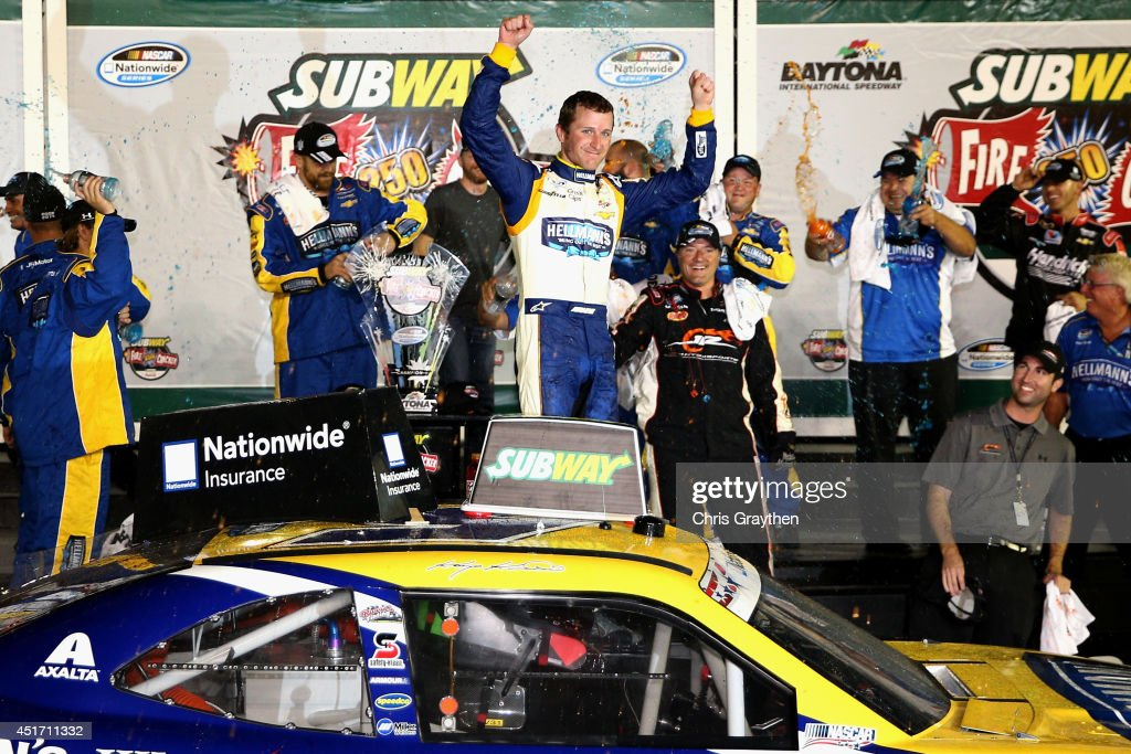 <a gi-track='captionPersonalityLinkClicked' href=/galleries/search?phrase=Kasey+Kahne&family=editorial&specificpeople=183374 ng-click='$event.stopPropagation()'>Kasey Kahne</a>, driver of the #5 Hellmann's Chevrolet, celebrates in victory lane after winning the NASCAR Nationwide Series Subway Firecracker 250 Powered by Coca-Cola at Daytona International Speedway on July 4, 2014 in Daytona Beach, Florida.