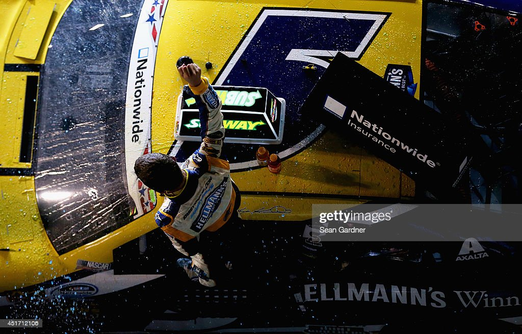 Kasey Kahne driver of the Hellmann's Chevrolet celebrates in Victory Lane after winning the NASCAR Nationwide Series Subway Firecracker 250 Powered...