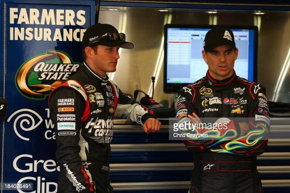 Kasey Kahne driver of the Hendrickcarscom Chevrolet and Jeff Gordon driver of the Axalta Coating Systems Chevrolet during practice for the NASCAR...