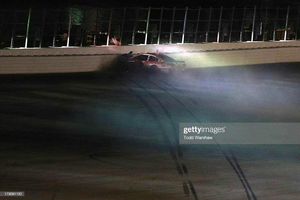 Kasey Kahne, driver of the #5 Hendrickcars.com Chevrolet, crashes into the backstretch wall during the NASCAR Sprint Cup Series Coke Zero 400 at Daytona International Speedway on July 6, 2013 in Daytona Beach, Florida.