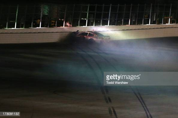 Kasey Kahne driver of the Hendrickcarscom Chevrolet crashes into the backstretch wall during the NASCAR Sprint Cup Series Coke Zero 400 at Daytona...