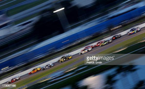 Kasey Kahne driver of the Hendrickcarscom Chevrolet leads a pack of cars during the NASCAR Sprint Cup Series Coke Zero 400 at Daytona International...