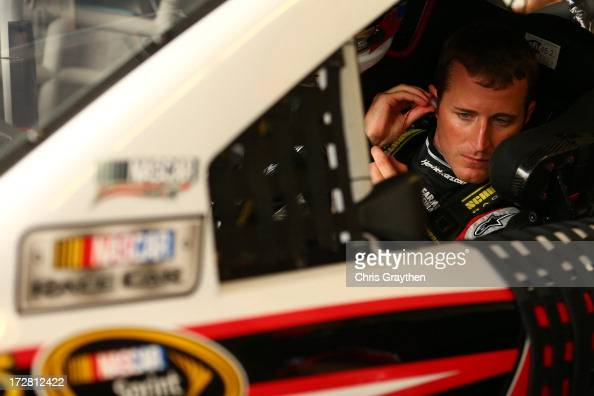 Kasey Kahne driver of the Hendrickcarscom Chevrolet sits in his car during practice for the NASCAR Sprint Cup Series Coke Zero 400 at Daytona...