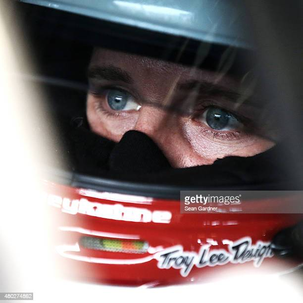 Kasey Kahne driver of the LiftMaster Chevrolet sits in his car during practice for the NASCAR Sprint Cup Series Quaker State 400 Presented by Advance...