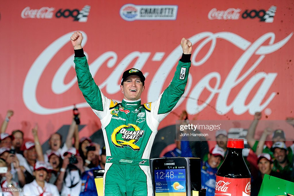 Kasey Kahne driver of the Quaker State Chevrolet celebrates in Victory Lane after winning the NASCAR Sprint Cup Series CocaCola 600 at Charlotte...