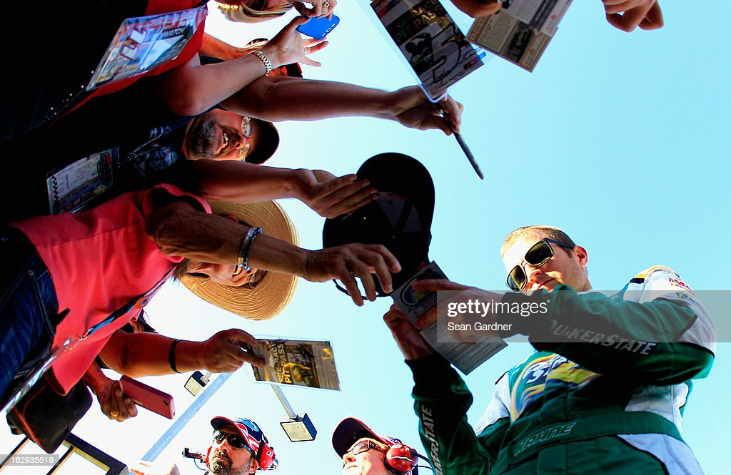 Kasey Kahne, driver of the #5 Quaker State Chevrolet, signs autographs during qualifying for the NASCAR Sprint Cup Series Subway Fresh Fit 500 at Phoenix International Raceway on March 1, 2013 in Avondale, Arizona.