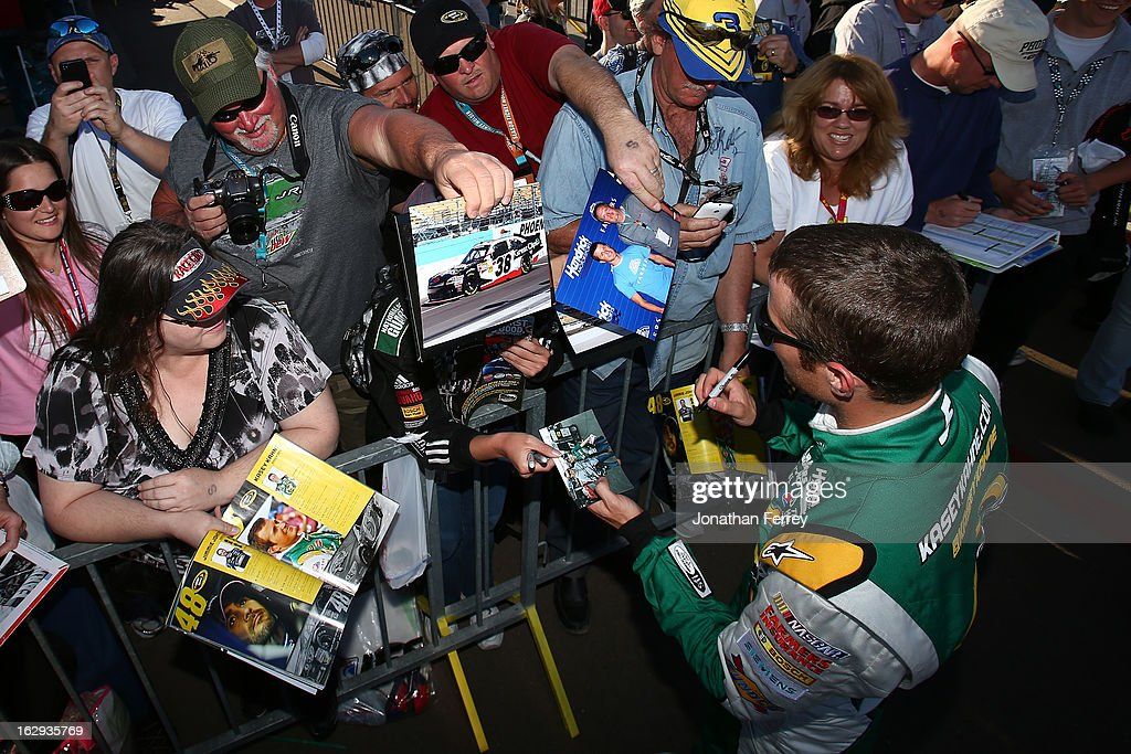 <a gi-track='captionPersonalityLinkClicked' href=/galleries/search?phrase=Kasey+Kahne&family=editorial&specificpeople=183374 ng-click='$event.stopPropagation()'>Kasey Kahne</a>, driver of the #5 Quaker State Chevrolet, signs autographs during qualifying for the NASCAR Sprint Cup Series Subway Fresh Fit 500 at Phoenix International Raceway on March 1, 2013 in Avondale, Arizona.