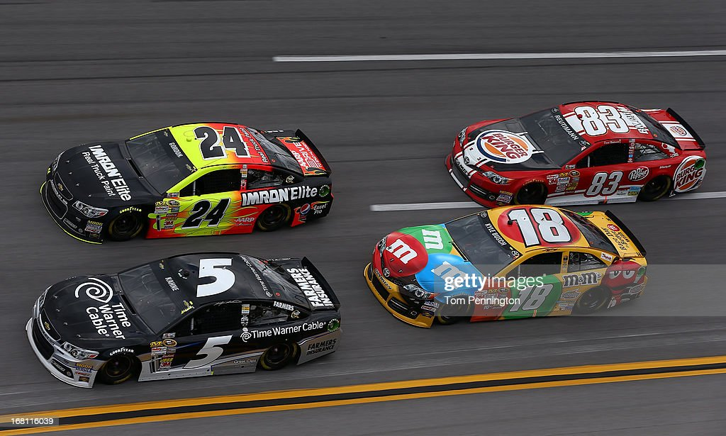 Kasey Kahne, driver of the #5 Time Warner Cable Chevrolet, and Jeff Gordon, driver of the #24 Imron Elite Chevrolet, lead Kyle Busch, driver of the #18 M&M's Toyota, and David Reutimann, driver of the #83 Burger King/Dr. Pepper Toyota, through turn four during the NASCAR Sprint Cup Series Aaron's 499 at Talladega Superspeedway on May 5, 2013 in Talladega, Alabama.